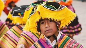 A south american wearing a yellow traditional headscarf and a colourful poncho to illustrate the range of languages we can translate for your life science or tech company
