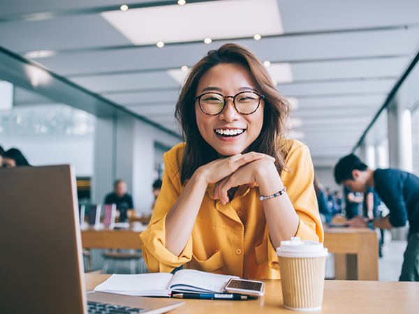 young, friendly looking chinese translator in a uk office