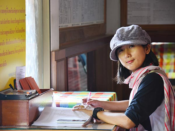 Young Thai woman working on a translation